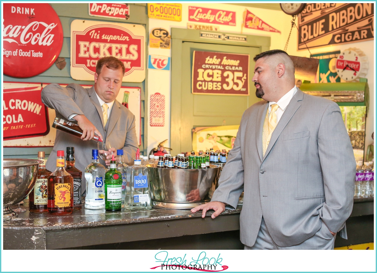 groom getting a drink at the bar