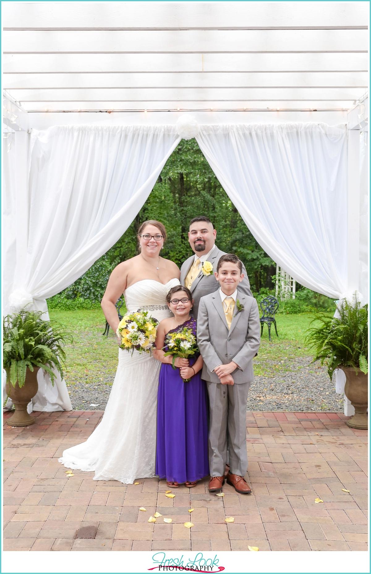 family of four wedding photo